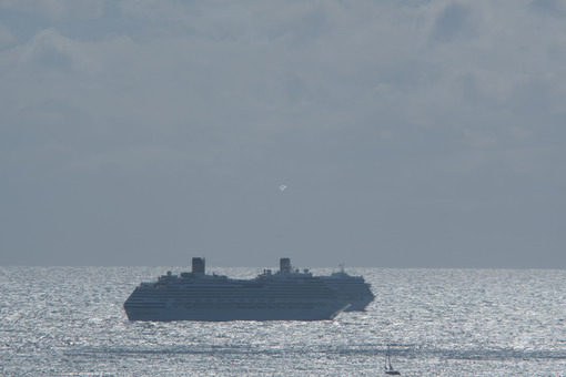 Cruise ships at sea. Cruise ships in the distance anchored in the rough sea. Stock photos. - MyVideoimage.com | Foto stock & Video footage