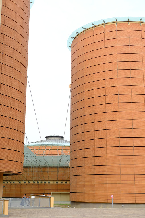 Cylinder building. Cylindrical buildings with brick facade. Stock photos. - MyVideoimage.com | Foto stock & Video footage