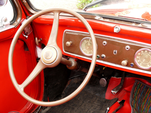 Dashboard with tools and steering wheel of a vintage car. - MyVideoimage.com