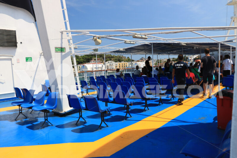 Deck of a ferry ship with crew and chairs. Blue and yellow color - MyVideoimage.com