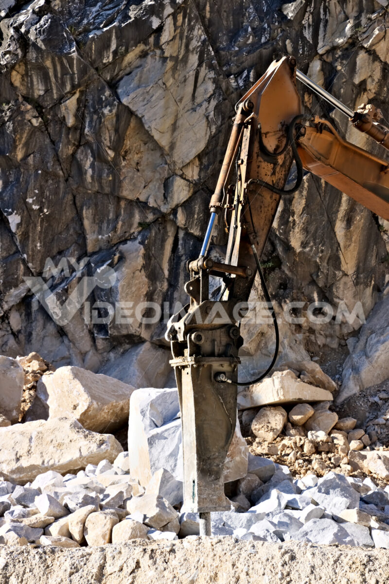 Demolition hammer in a quarry of white Carrara marble. - MyVideoimage.com