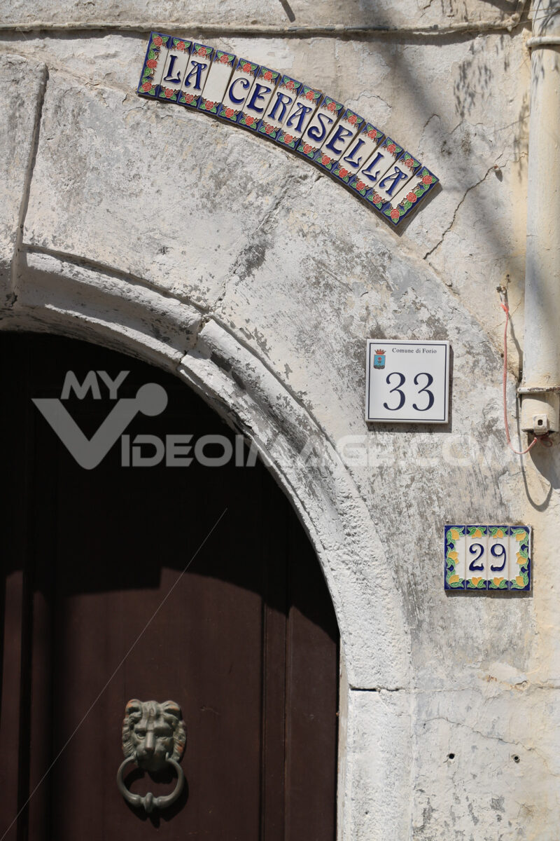 Detail of an arched door with glazed ceramic decorations and pla - MyVideoimage.com