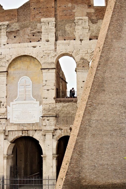 Detail of the Colosseum also called the Flavian Amphitheater. The construction is made of travertine marble. - MyVideoimage.com