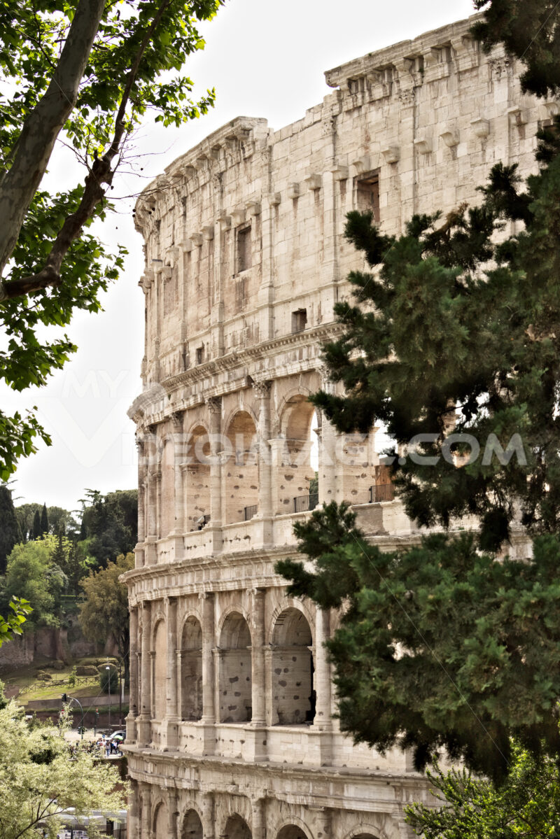Detail of the Colosseum also called the Flavian Amphitheater. The construction is made of travertine marble. - LEphotoart.com