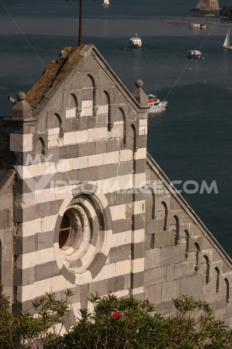 Detail of the facade of the church of Portovenere in white and gray marble in typical Ligurian Romanesque style. - LEphotoart.com