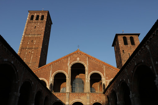 Detail of the facade of the church of Sant'Ambrogio in Milan built with red bricks. Milano foto. - LEphotoart.com