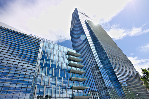 Diamond tower, modern buildings with curtain wall facades in glass. - MyVideoimage.com
