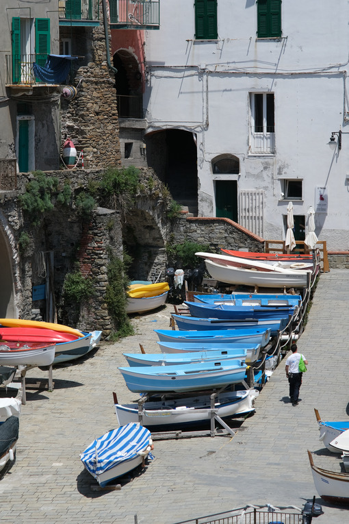 Dry boats parked in the town square during the coronavirus in the Cinque Terre.  Royalty Free Photos. - MyVideimage.com