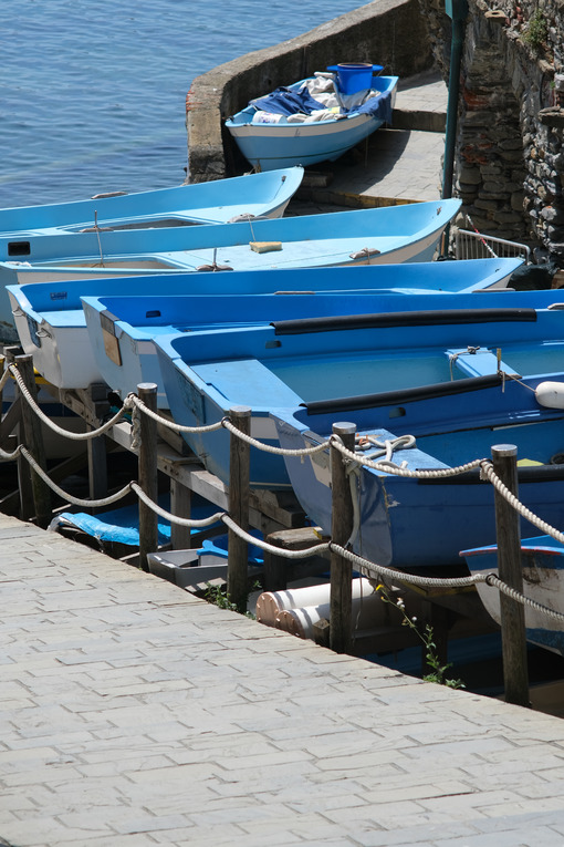 Dry boats parked in the town square during the coronavirus in the Cinque Terre.  Royalty Free Photos. - LEphotoart.com