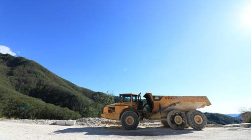 Dumper truck used in a Carrara marble quarry. Large yellow dum - MyVideoimage.com