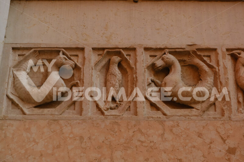 Embossments in relief on the facade of the baptistery of Parma. Sculptures on red marble from Verona - MyVideoimage.com