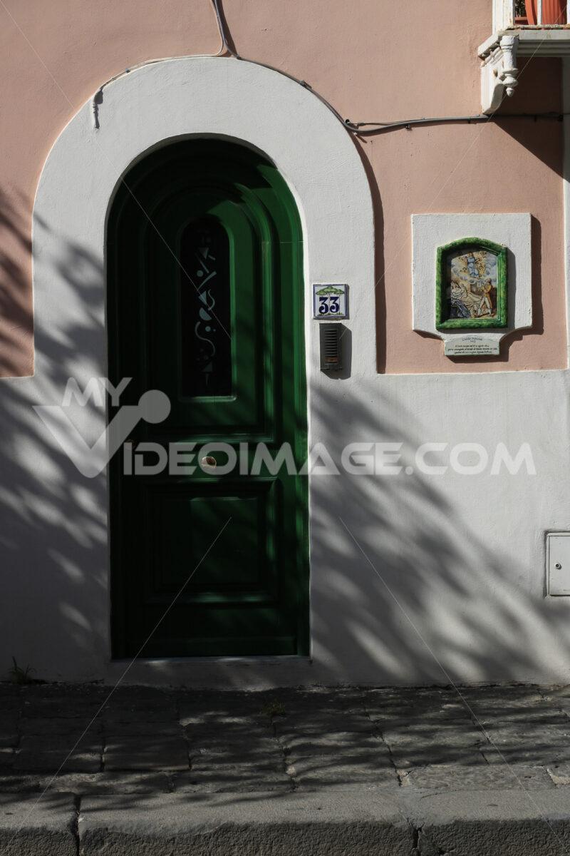 Entrance door to a Mediterranean home. Green plasters and cerami - MyVideoimage.com