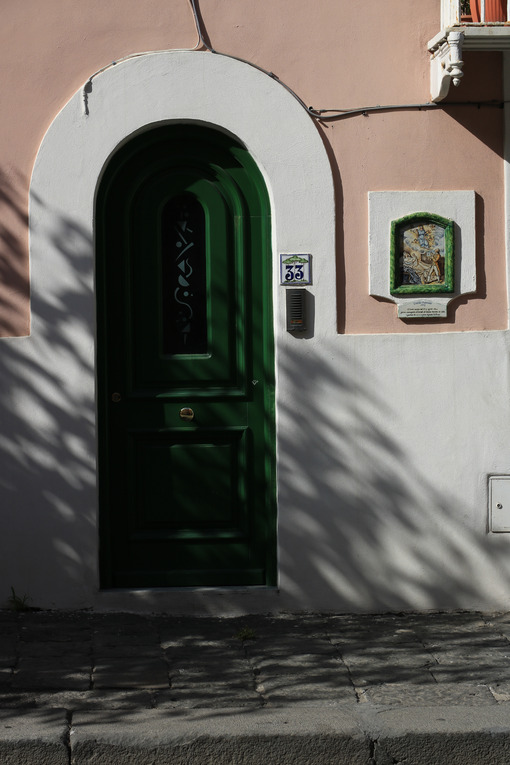 Entrance door to a Mediterranean home. Green plasters and cerami - MyVideoimage.com