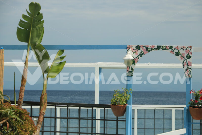 Entrance to bathing establishment. Bow with banana plant. In the - MyVideoimage.com