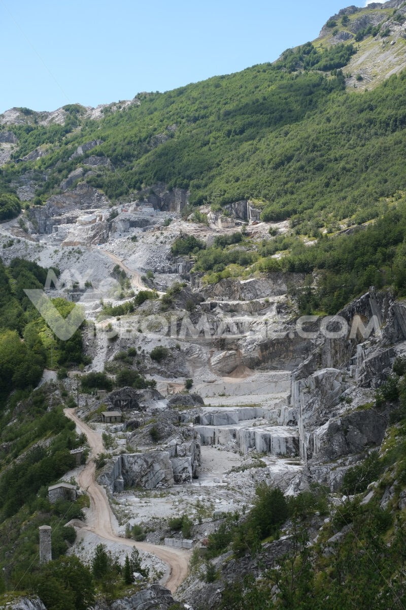 Environmental damage. Destruction of the environment in a marble quarry in the Apuan Alps in Tuscany. Stock photos. - MyVideoimage.com | Foto stock & Video footage