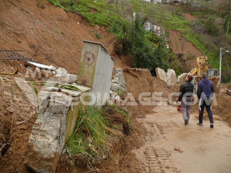 Environmental disaster due to climate change and human neglect. Overturning of a retaining wall due to rain. - LEphotoart.com