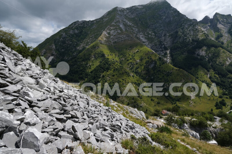 Environmental instability. Destruction of the environment in a marble quarry in the Apuan Alps in Tuscany. Stock photos. - MyVideoimage.com | Foto stock & Video footage