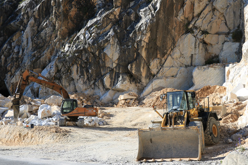 Excavator and a bulldozer in a Carrara marble quarry. Cave di marmo. - LEphotoart.com