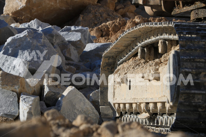 Excavator tracks in a marble quarry. Large excavators help men t - LEphotoart.com