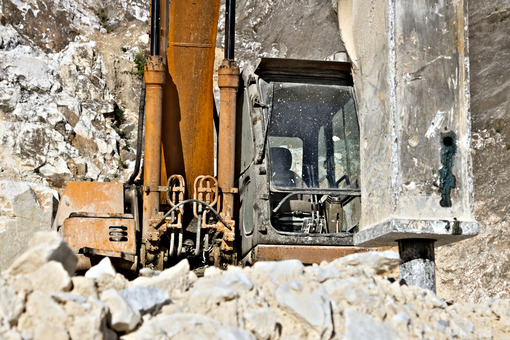 Excavator with demolition hammer in a Carrara marble quarry. A l - LEphotoart.com