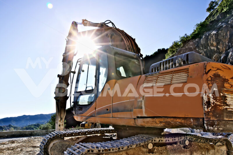 Excavator with demolition hammer in a Carrara marble quarry. Cave marmo. - LEphotoart.com
