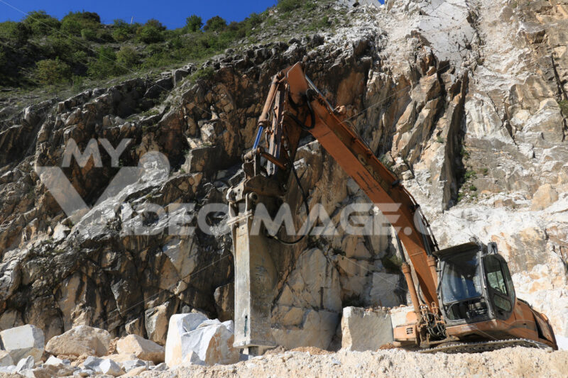 Excavator with demolition hammer in a Carrara marble quarry. Royalty free photo. - LEphotoart.com