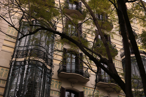 Facade of a building from the early twentieth century with balconies and floral decorations - MyVideoimage.com
