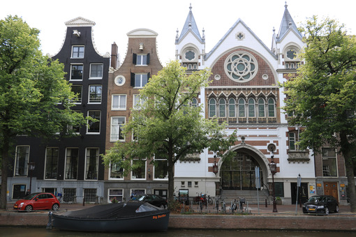Facade of a neo-gothic church next to characteristic Dutch brick - MyVideoimage.com