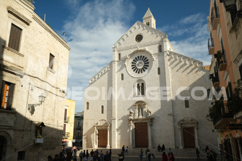 Facade of the Cathedral of San Sabino in Bari in limestone. Church with light stone walls with the blue sky background with clouds. Foto Bari photo.