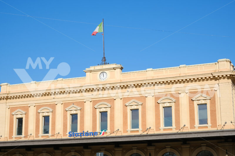 Facade of the Parma railway station. The Italian flag is placed on the building. - MyVideoimage.com
