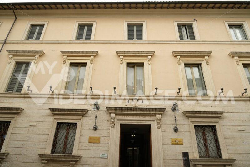 Facade of the building that houses the Cassa di Risparmio di Foligno Foundation. Travertine marble cladding. - MyVideoimage.com