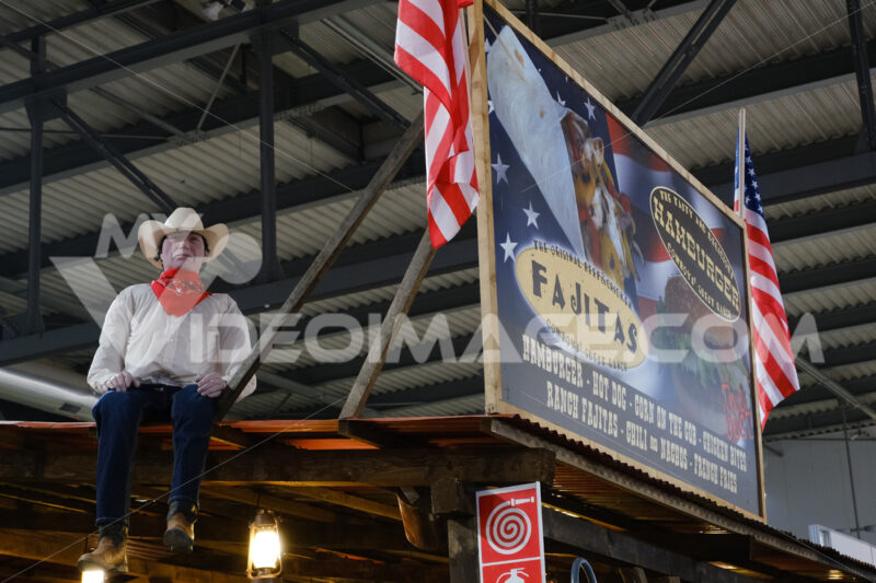 Fast food signboard with cowboy puppet. Milan Craft Fair. - MyVideoimage.com