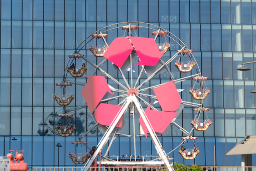 Ferris wheel with arrows symbols at the three Citylife towers in Milan. Between the mall and the skyscrapers a small ferris wheel. - MyVideoimage.com