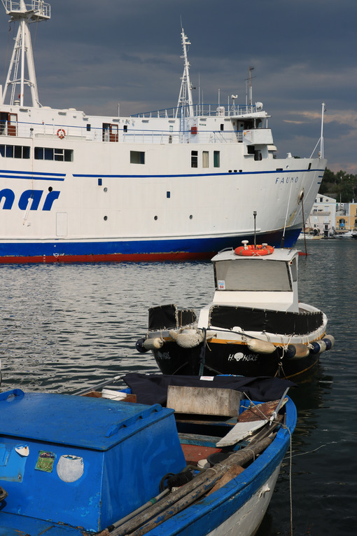Ferry boat enters the port. The port of Ischia is housed in an a - MyVideoimage.com