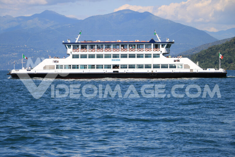 Ferry boat plows the waters of Lake Maggiore. In the background - MyVideoimage.com