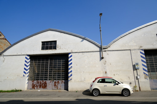 Fiat 500 new model. Fiat 500 new model parked in front of workshop. Stock photos. - MyVideoimage.com   Foto stock & Video footage