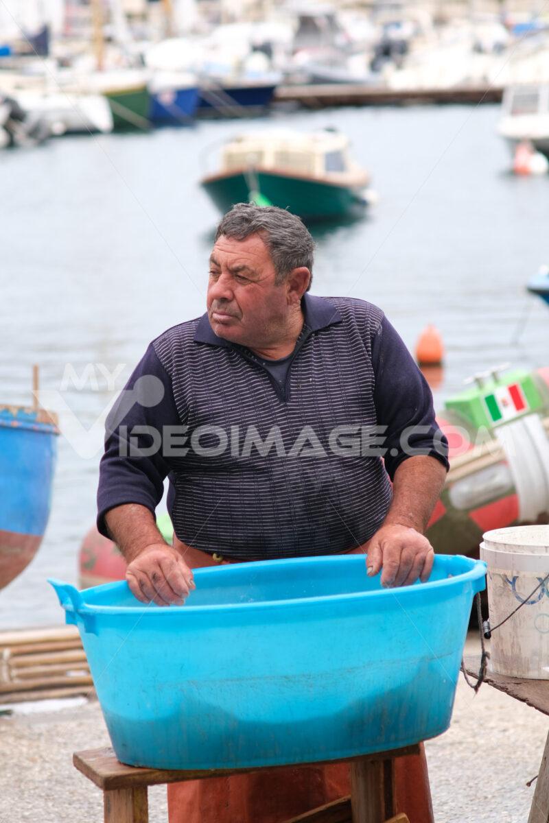 Fisherman at the port of Bari. At the market near the port the fishermen sell the fish caught. - MyVideoimage.com