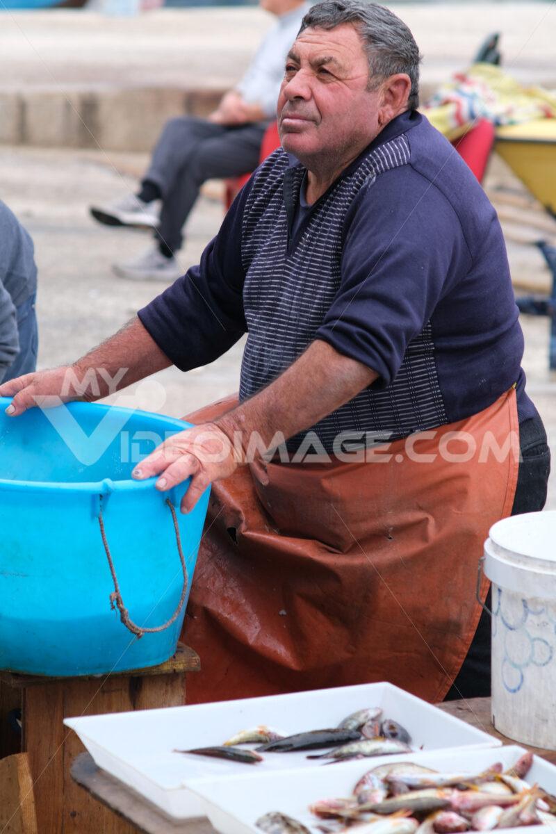 Fisherman at the port of Bari. At the market near the port the fishermen sell the fish caught. Foto Bari photo.