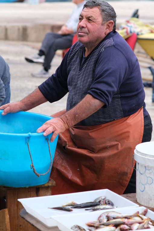 Fisherman at the port of Bari. At the market near the port the fishermen sell the fish caught. Foto Bari photo.