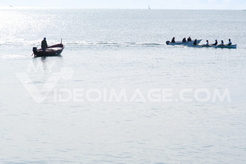 Fisherman's boat in the Ligurian sea, Gulf of La Spezia and boat with athletes in regatta training. - MyVideoimage.com