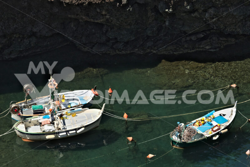 Fishing boats in the harbor. View from above. In the village of Framura, near the Cinque Terre a blue sea and dreamlike landscapes. - LEphotoart.com