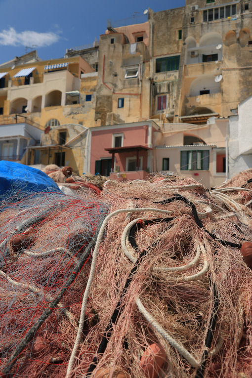 Fishing net on the dock. Fishing net on the dock of the port of Corricella, Procida. - MyVideoimage.com | Foto stock & Video footage