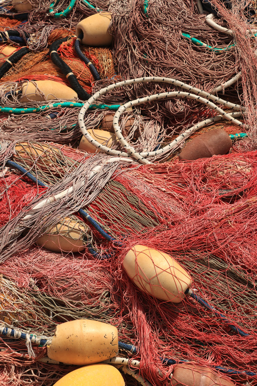 Fishing net. Fishing net stacked in the harbor. - MyVideoimage.com | Foto stock & Video footage