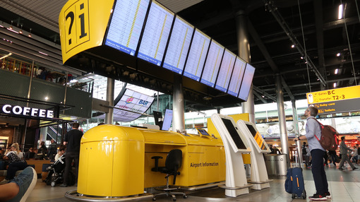 Flight info board at Amsterdam Schiphol airport. Help desk with display of aircraft departure times. - MyVideoimage.com