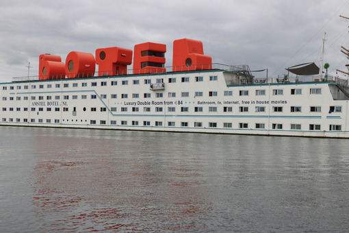 Floating hotel in Amsterdam NDSM. The BOTEL ship is moored . Foto navi. Ships photo.