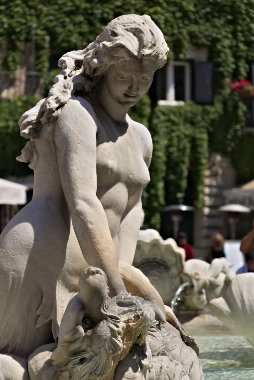 Fountain of Neptune in Piazza Navona, Rome. Sculpture of a woman - MyVideoimage.com