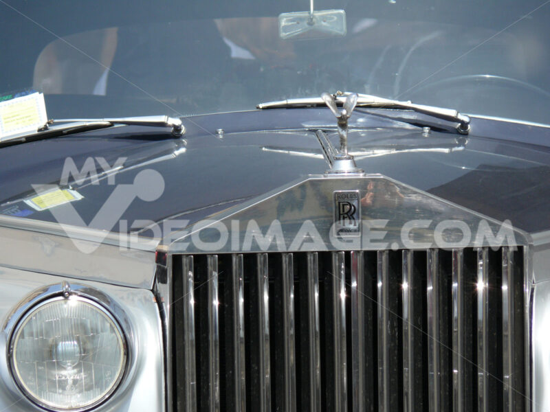 Front of a luxurious Rolls Royce car with a sculpture of a chromed metal angel. - MyVideoimage.com