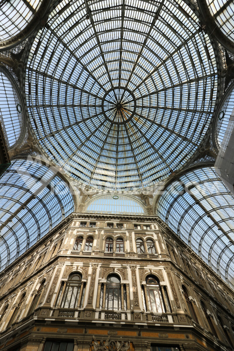 Galleria Umberto in Naples. On the ground floor it is populated by numerous and luxurious shops. The ceiling is made with a large and spectacular window. - MyVideoimage.com