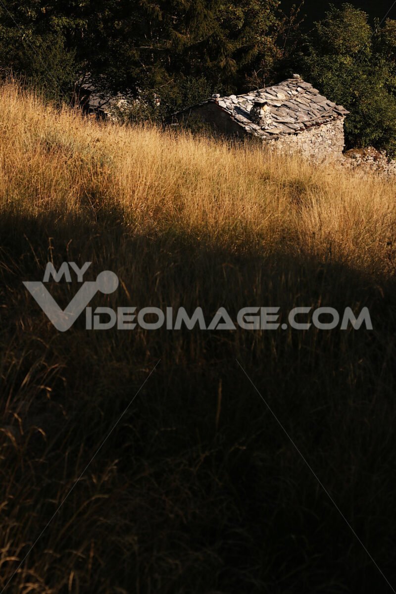 Garfagnana Italy. Garfagnana, Campocatino, Apuan Alps, Lucca, Tuscany. Italy. Small house in stone and white marble stones - MyVideoimage.com | Foto stock & Video footage