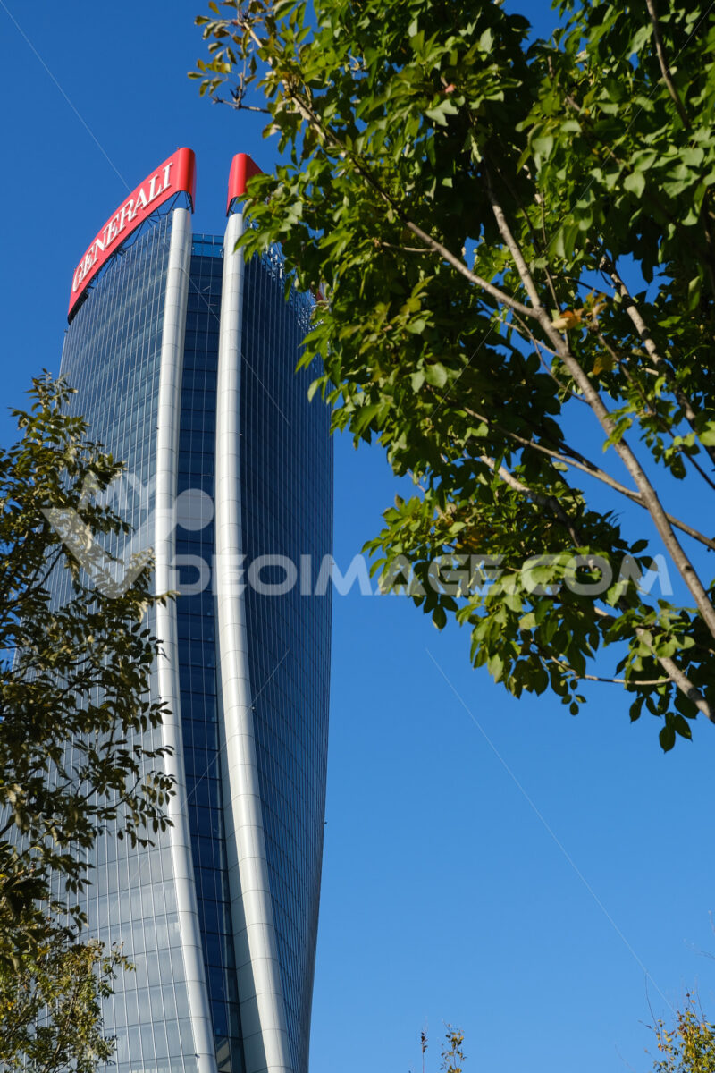Generali Assicurazioni skyscraper in Milan Citylife surrounded by trees with green leaves. Società. Company building - LEphotoart.com